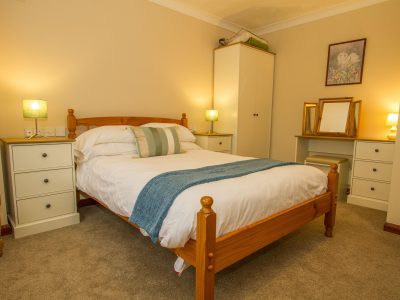 Double bedroom on the main floor of Apartment 3, Seaview, which has an ensuite bathroom with shower over