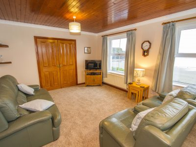 Lounge of Apartment 3 showing view over the beach, Broad Haven, St. Brides Bay, Pembrokeshire