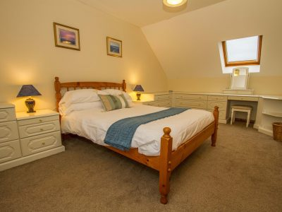 Double bedroom on the top floor of Apartment 3, Seaview, with window overlooking St Brides Bay