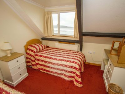 Twin bedroom in apartment 5, overlooking the sea of St Brides Bay, Pembrokeshire