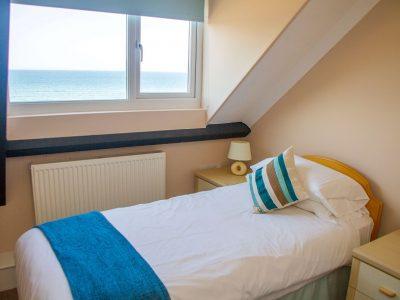 Twin bedroom in apartment 4 overlooking St Brides Bay, Pembrokeshire