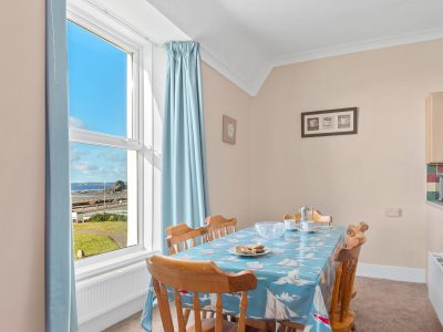 The dining area in Apartment which has a sea view and seats 6 around the large table 2