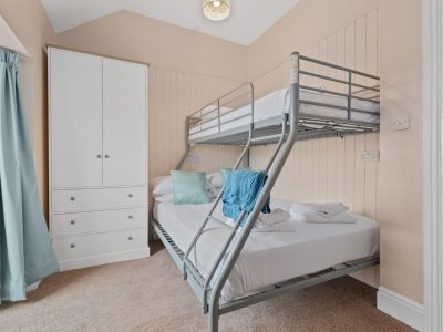 Family room in Apartment 2 with bunk beds, the lower one being a double. The room overlooks Broad Haven beach