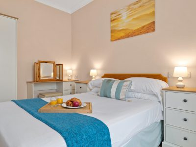 Double bedroom with dressing table, Apartment 2. This room has a seaview